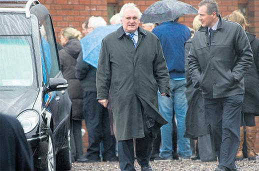 Former Taoiseach Bertie Ahern arrives for Leana Martin's removal yesterday