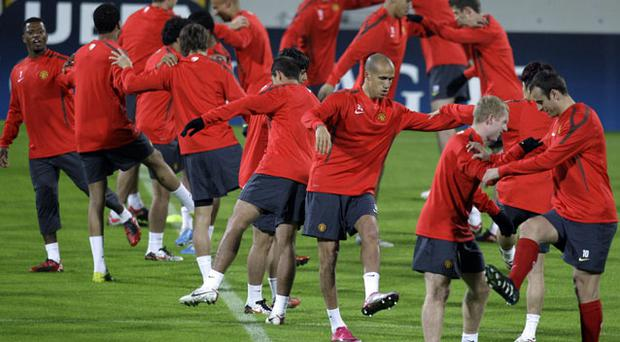 Manchester United players go through a stretching routine at training last night prior to tonight's game against Bursaspor. Photo: AP