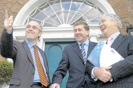 Former Anglo Irish director Tom Browne is flanked by the bank's former chief executive David Drumm (left) and chairman Sean FitzPatrick in 2004