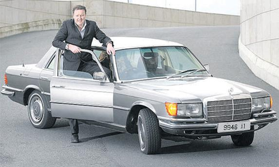 Dave Lawlor with his metallic-bronze Mercedes 450 SEL at Park West, Dublin. The Mercedes was owned by Bono until he auctioned it off for charity in 2000
