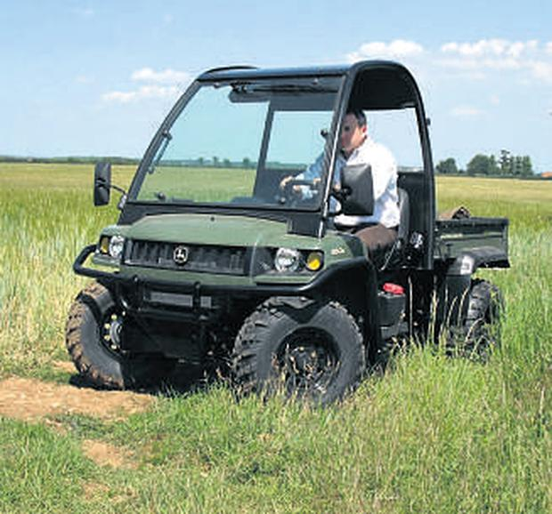 The new Deere utility vehicle is now in olive ad black livery