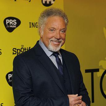 Welsh singer Sir Tom Jones arrives for the 2010 Music Industry Awards at a central London hotel (AP)