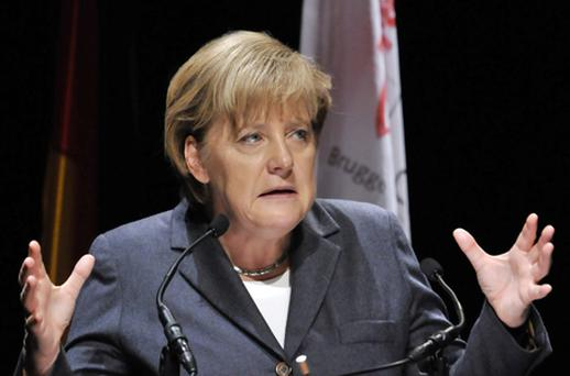 Angela Merkel: stepping up demands for investors to help pay for any future European debt crisis. Photo: Getty Images
