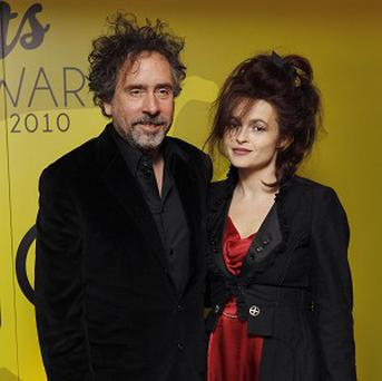 Tim Burton and Helena Bonham Carter were bidding to get their hands on one of Sir Tom Jones's rings