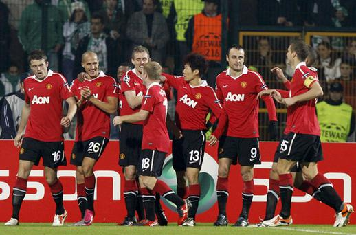 Manchester United players celebrates Darren Fletcher's goal against Bursaspor during the Champions League clash in Turkey last night - United won 3-0. Photo: Reuters