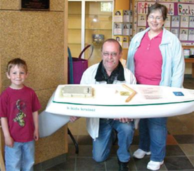 Mary Bagley of Old Town Elementary School, Maine with her husband, David, and pupil Aidan, who won the contest to name the boat