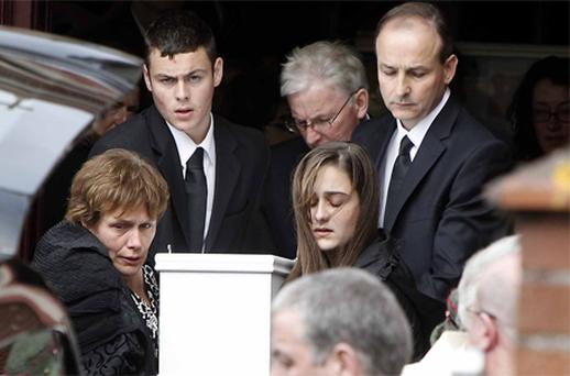 Micheal Martin, his wife Mary, son Micheal Aodh (16) and daughter Aoibhe (14) at the church