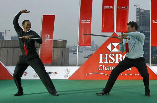 Tiger Woods and Lee Westwood perform the Chinese martial art of taichi in the financial district of Shanghai yesterday. Photo: Andy Wong / AP