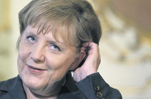 German Chancellor Angela Merkel answers questions in Brussels yesterday. Photo: Reuters / Thierry Roge