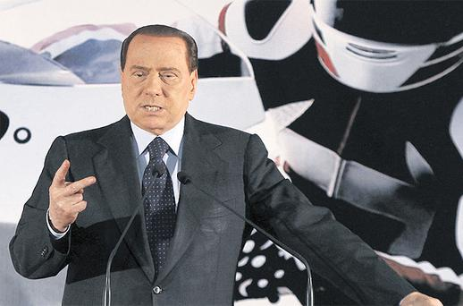 Italian Premier Silvio Berlusconi delivers his address during a bike fair in Milan, Italy, yesterday. Mr Berlusconi created a new uproar by claiming it was better to love beautiful girls than gays, sparking outrage, and fresh calls for him to step down