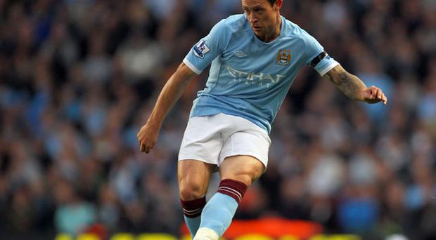 Manchester City manager Roberto Mancini is prepared to sell Wayne Bridge in January. Photo: Getty Images