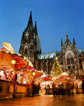 "Cologne, Germany <br/> The market at the Cologne Cathedral is the most impressive one of Cologne's Christmas markets due to the backdrop of the imposing Cathedral. You can find 160 attractively designed wooden pavilions. Here you can choose from numerous sweet delicacies, watch artisans at work and enjoy the ""Original Christmas mulled wine"" out of the festively decorated Christmas mugs."