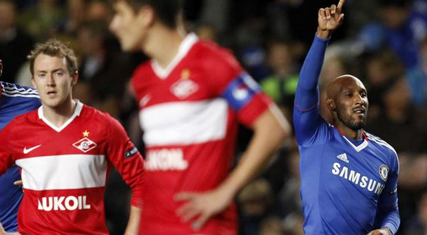 Spartak Moscow's Aiden McGeady (L) puts his hands on his hips as Nicolas Anelka celebrates his goal for Chelsea. Photo: Reuters