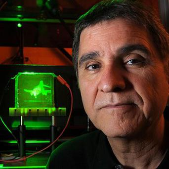 Professor Nasser Peyghambarian, with a refreshable, holographic image of an F-4 Phantom Jet