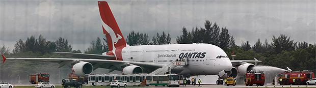 The Qantas Airways A380 is sprayed by rescue services after making an emergency landing at Changi airport in Singapore. Photo: Reuters
