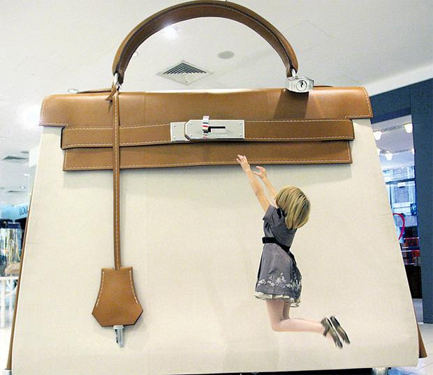 Jane Murray (8) from Drumcondra beside the giant Hermes Kelly bag in Brown Thomas yesterday.