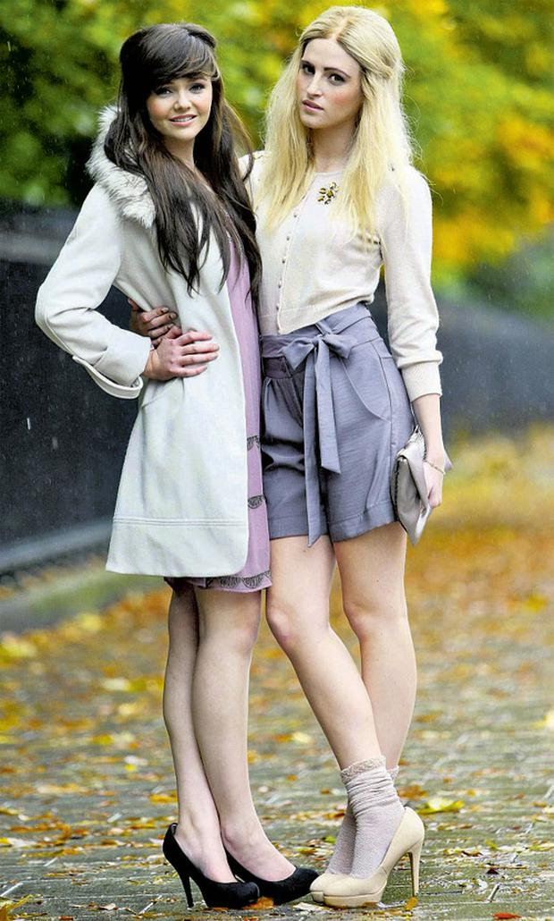 Models Amber Rowan and Hannah May (on left) wearing party outfits from A-Wear's new Christmas collection