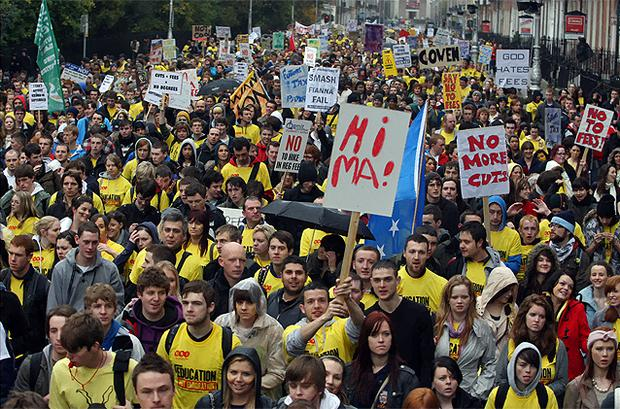 Thousands of student protesters make their way along Merrion Street towards Leinster House yesterday. Photo: Tom Burke