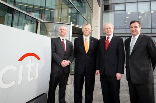 First and Deputy First Ministers Peter Robinson and Martin McGuinness are met by Bill Mills (right) and Brian McAreavey of Citi outside Citi's Belfast offices. Photo: PA