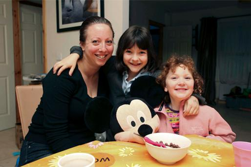 Annagh Minchin with her two daughters, Siban (7) and Aife (6) at her home in Ballina, Co Tipperary