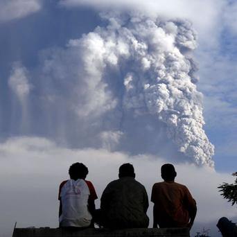 Villagers watch as Mount Merapi volcano erupts, as seen from Wukirsari village in Sleman, Indonesia. Photo: Reuters