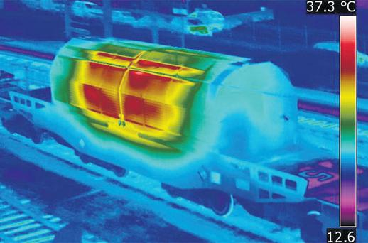 A thermography image shows a nuclear transport container at a railway yard in Valognes, Normandy. The nuclear waste left France yesterday and is scheduled to arrive for storage in Gorleben, Germany, tomorrow.