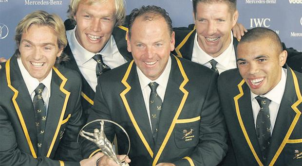 Bakkies Botha celebrates South Africa's World Cup success with teammates Percy Montgomery, Schalk Burger, Coach Jake White, Bryan Habana and Butch James at the Laureus Team of the Year award presentation