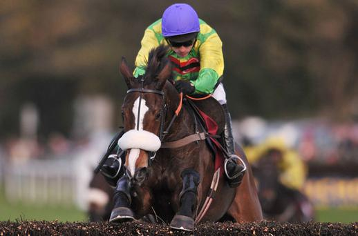 Kauto Star and Ruby Walsh soar over the final fence on their way to victory at Down Royal two years ago - the pair can repeat the dose today. Photo: Sportsfile