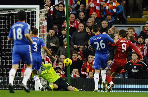 Fernando Torres scores in yesterday's match against Chelsea. Photo: Getty Images