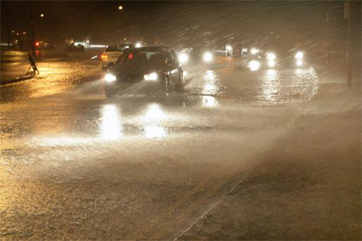 The sea pours over the road at Seapoint in Salthill, Galway, yesterday evening due to high tides and wind