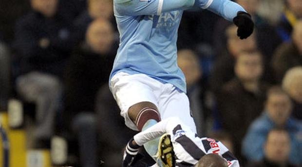 Mario Balotelli puts the boot in to Youssouf Mulumbu. Photo: Getty Images