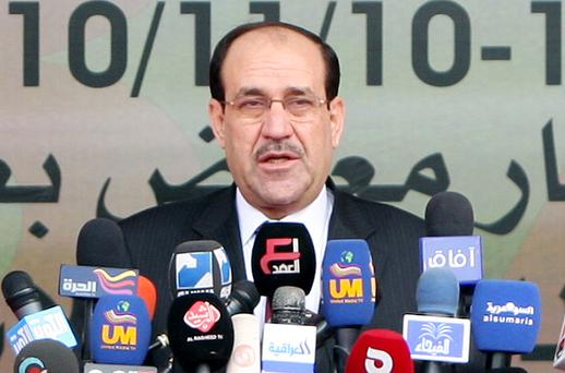 Iraq's political groups have reached a power-sharing agreement in which Nouri al-Maliki will stay on as prime minister. Photo: Getty Images