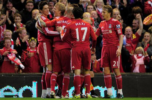 Fernando Torres (far left) and his Liverpool team-mates had plenty to celebrate after the Spaniard's two goals saw off Chelsea on Sunday. Photo: Getty Images