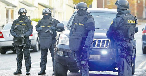 Garda Emergency Response Unit members during a series of raids at Oriel Street Lower in Dublin's north inner city yesterday