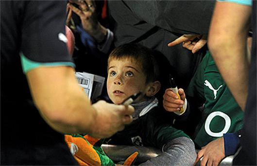 Daniel Kane (5), from Lucan, Co Dublin, waits as Jonathan Sexton signs an autograph for him yesterday