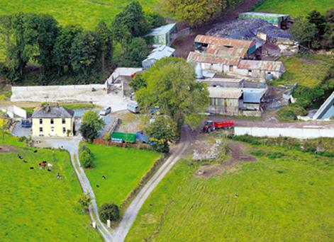 The avenue to the farm divides to give separate entrances to the two-storey, three-bedroom farmhouse and the farmyard