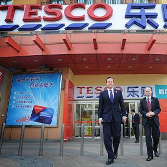 David Cameron popped into Tesco after landing in Beijing, China