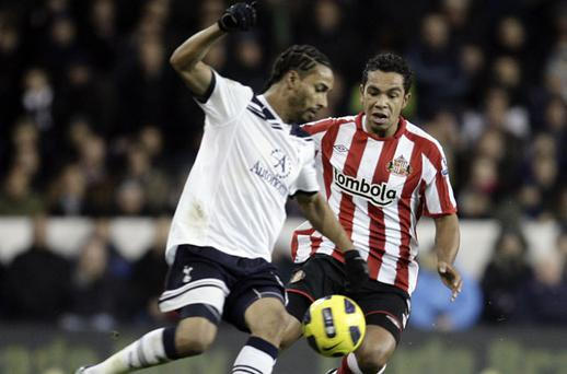 Sunderland's Kieran Richardson tackles Tottenham Hotspur's Benoit Assou-Ekotto during their Premier League match at White Hart Lane last night. Photo: Getty Images