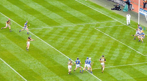 Henry Shefflin strikes his penalty in the 2009 All-Ireland final from well in front of the 20-metre line despite the efforts of Tipperary's defenders, who are all well ahead of the goal-line. Photo: Daire Brennan / Sportsfile