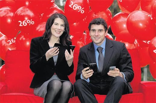 Eavann Murphy, head of enterprise marketing, Vodafone Ireland, with GAA Footballer of the Year 2010 and All-Star Dublin player Bernard Brogan, at the announcement of the telco's results