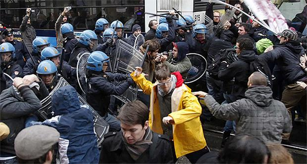 Demonstrators clash with police outside Padua's prefecture where Italian Premier Silvio Berlusconi was meeting with authorities to discuss flooding in the region