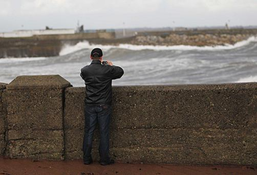All seemed swell as this man took a picture of raging seas in Dun Laoghaire, Co Dublin...