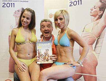 Michael O'Leary, Ryanair's chief executive, poses with stewardesses to promote the launch of the 2011 Cabin Crew Charity Calendar in Berlin. Photo: Reuters