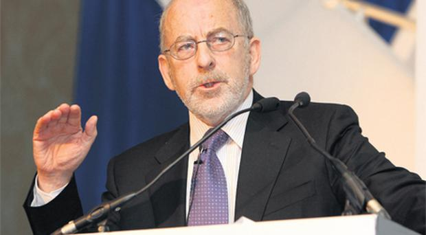 Prof Patrick Honohan, Governor of the Central Bank, addressing the International Financial Services Summit 2010 held in the Four Seasons hotel yesterday. He said he would welcome the sale of Irish banks to foreign lenders. Photo: Tom Burke
