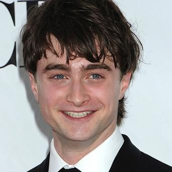 Daniel Radcliffe has been encased in mud