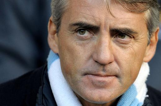 Man City boss Roberto Mancini missed a golden opportunity to lay down a marker against their bitter rivals. Photo: Getty Images