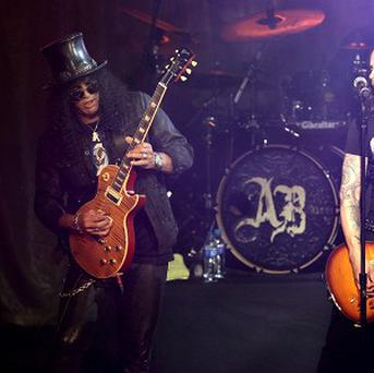 Slash, left, performed on stage with Alter Bridge at the Marshall Classic Rock Roll of Honour