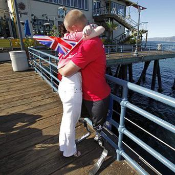 Mark Ormrod embraces his wife after completing a charity run across America