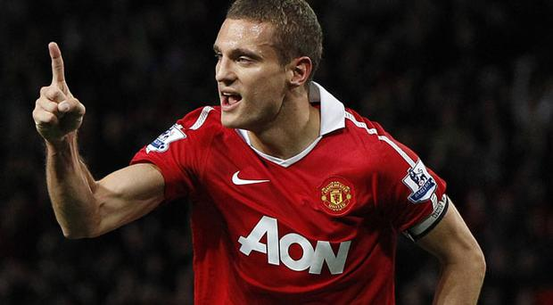 Vidic scores the equaliser for Utd. Photo: Reuters