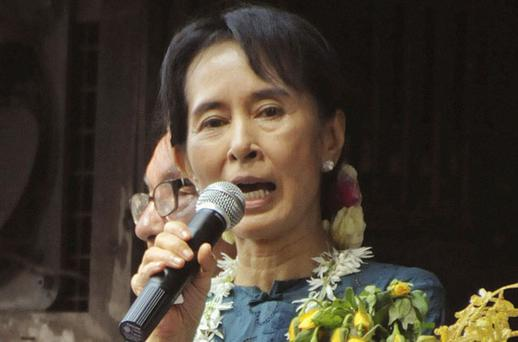 Aung San Suu Kyi told thousands of cheering supporters she will continue to fight for human rights. Photo: Reuters